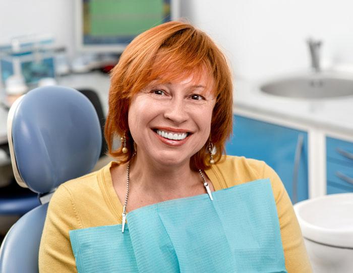 Happy patient after having dentures treatment