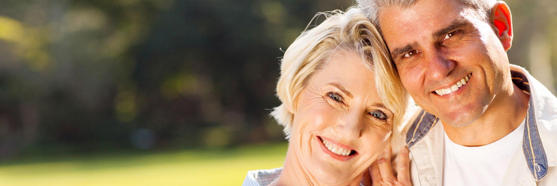 Happy senior couple who had a dentures treatment