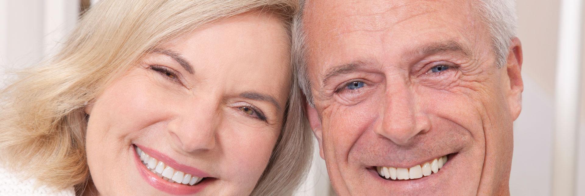 Happy senior couple who had a general dentistry treatment