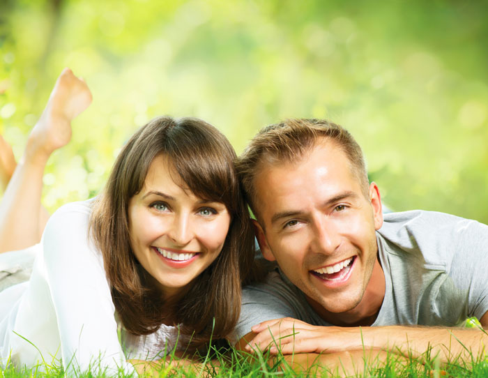 Happy Smiling Couple Together Relaxing on Garden