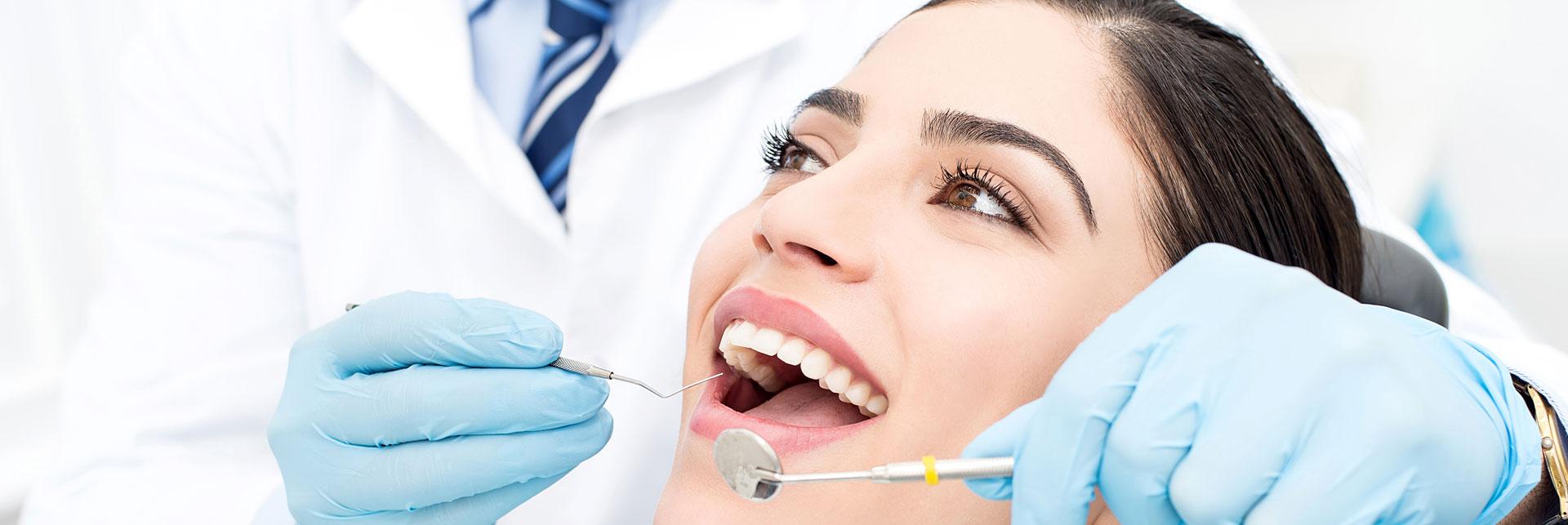 A dentist doing gum disease treatment