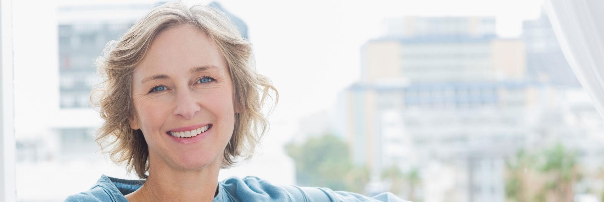 Happy woman who had a restorative care treatment