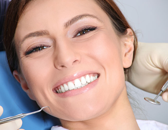 Woman after  having teeth whitening treatment