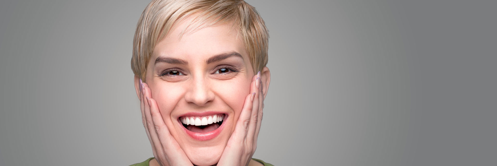 Happy woman who had teeth whitening treatment